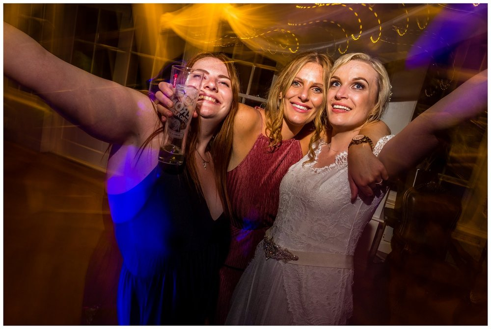 bride and girls dancing