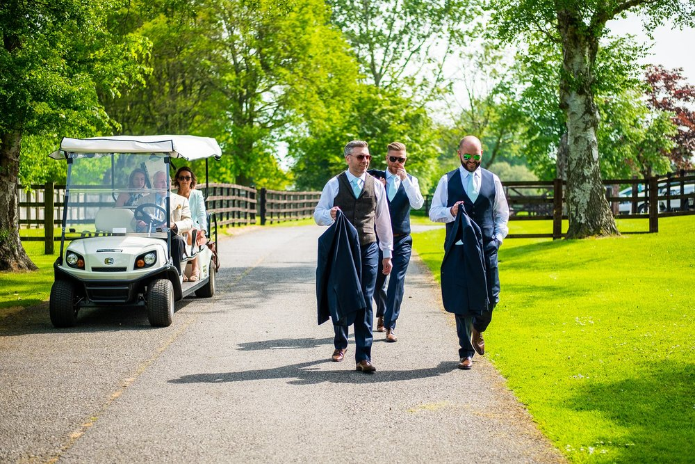 groomsmen walking to venue