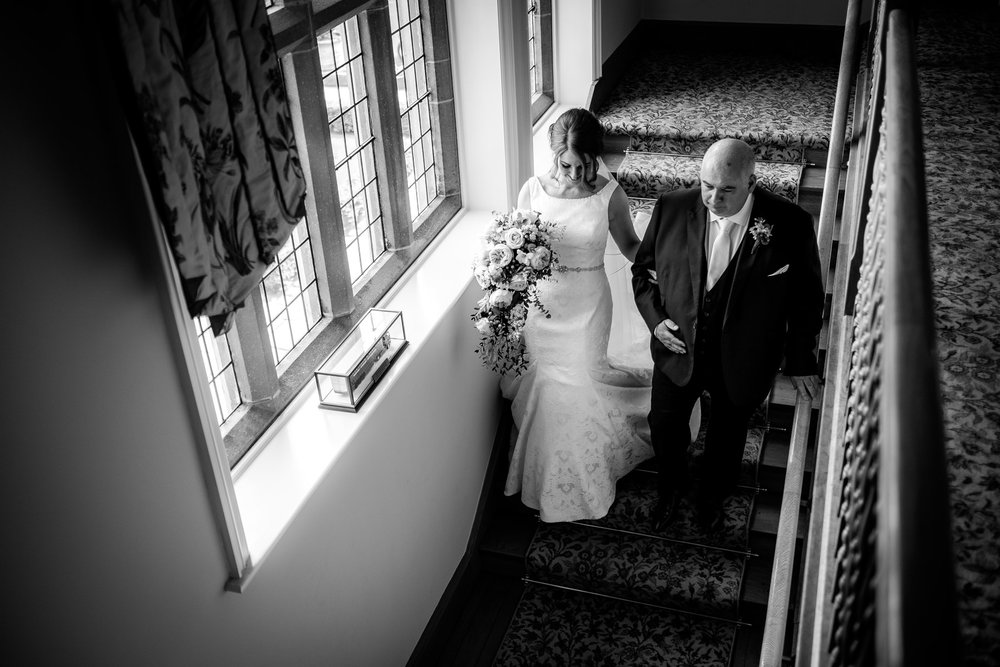 bride and father walking down stairs