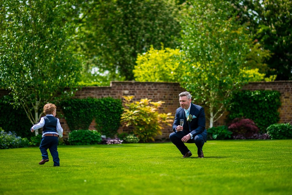groom playing with son