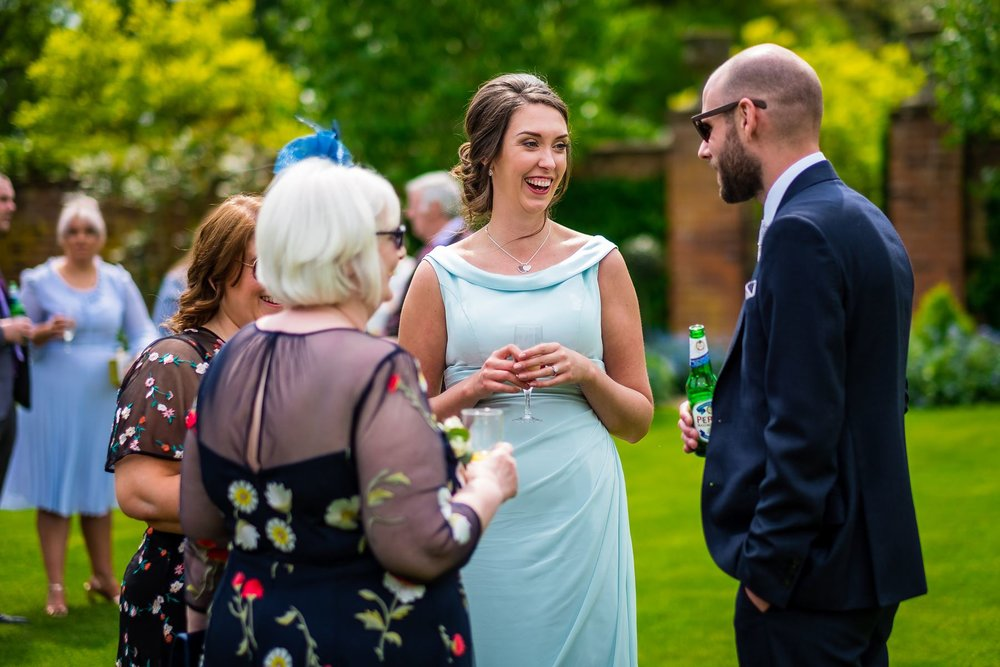 bridesmaid talking to guests