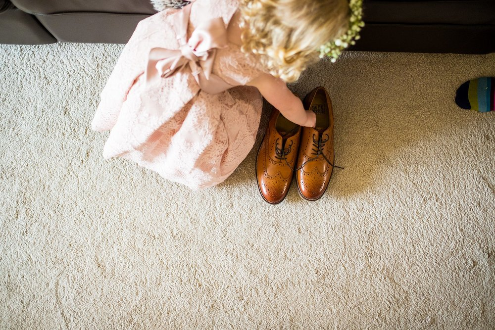 flower girl picking up shoes