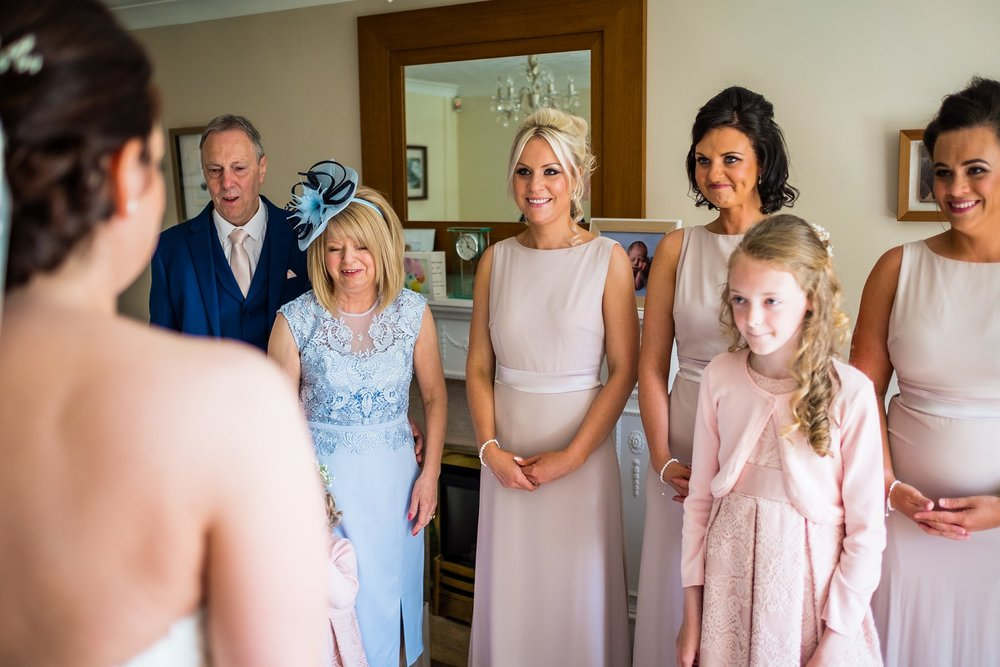 family seeing bride for the first time in dress