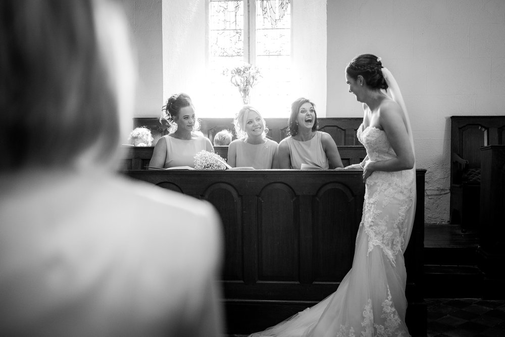 bride chatting with bridesmaids
