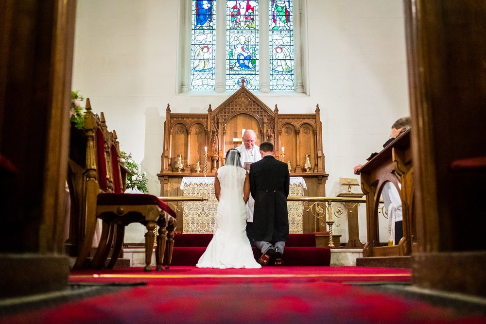 bride and groom at alter