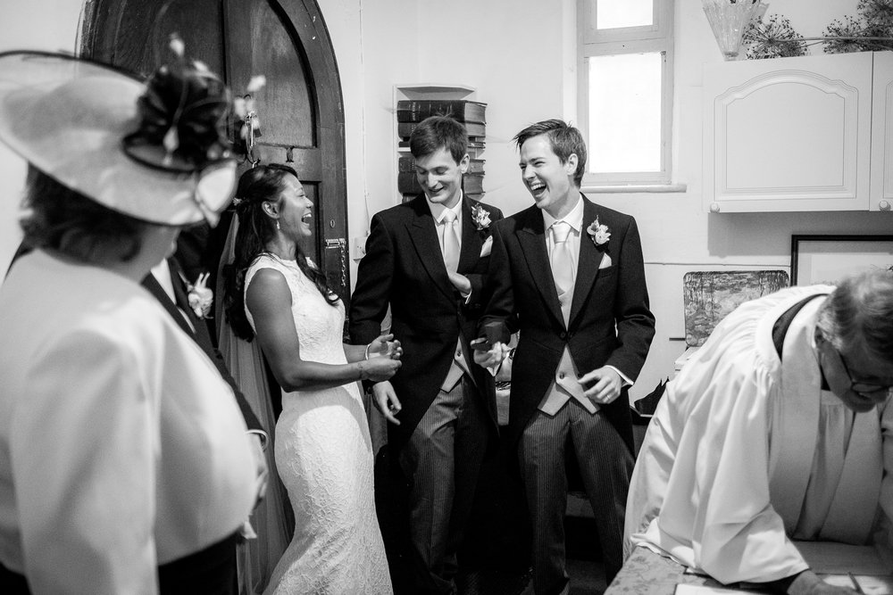 wedding party laughing during signing