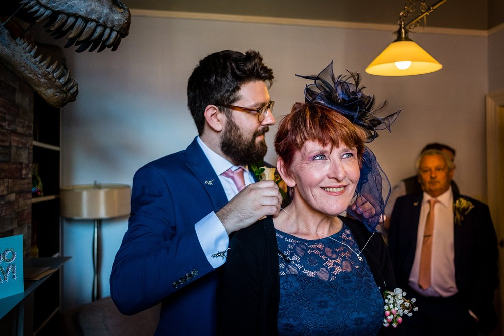 groom helping mum