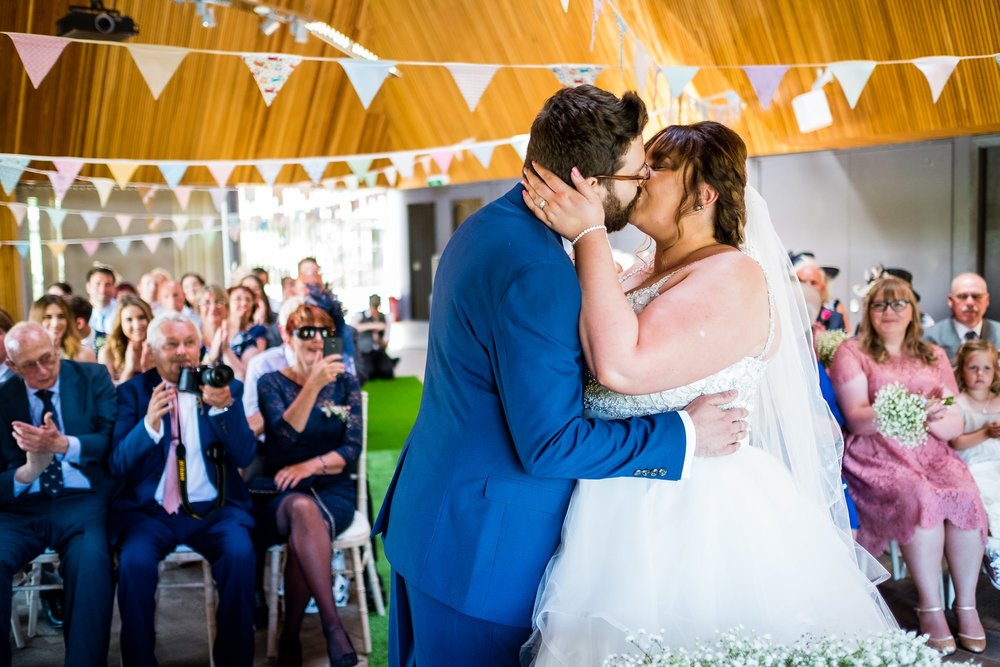 bride and groom first kiss at brockholes
