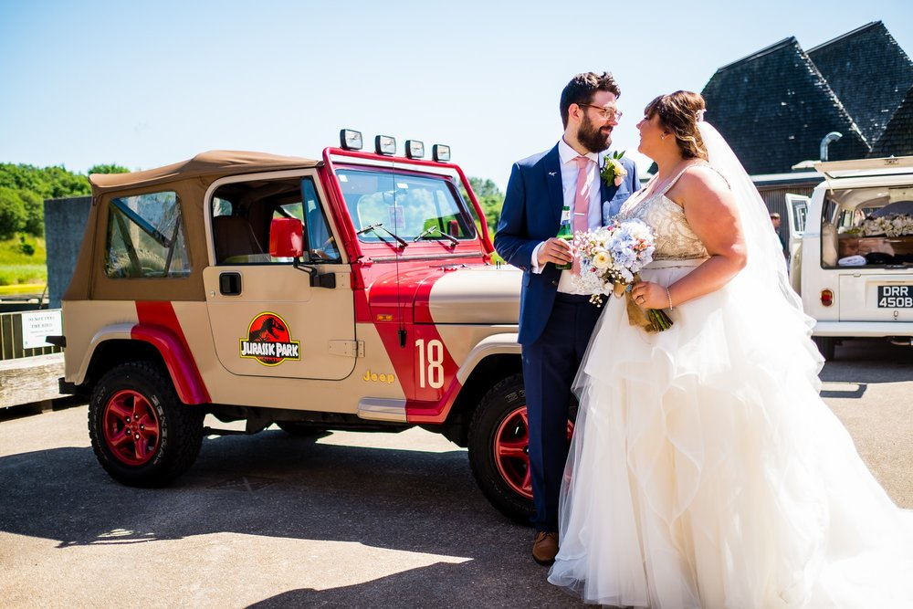 bride and groom with jurassic park jeep