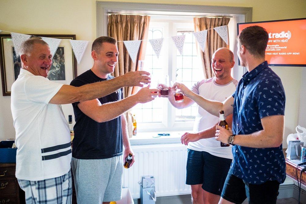 groomsmen with drinks