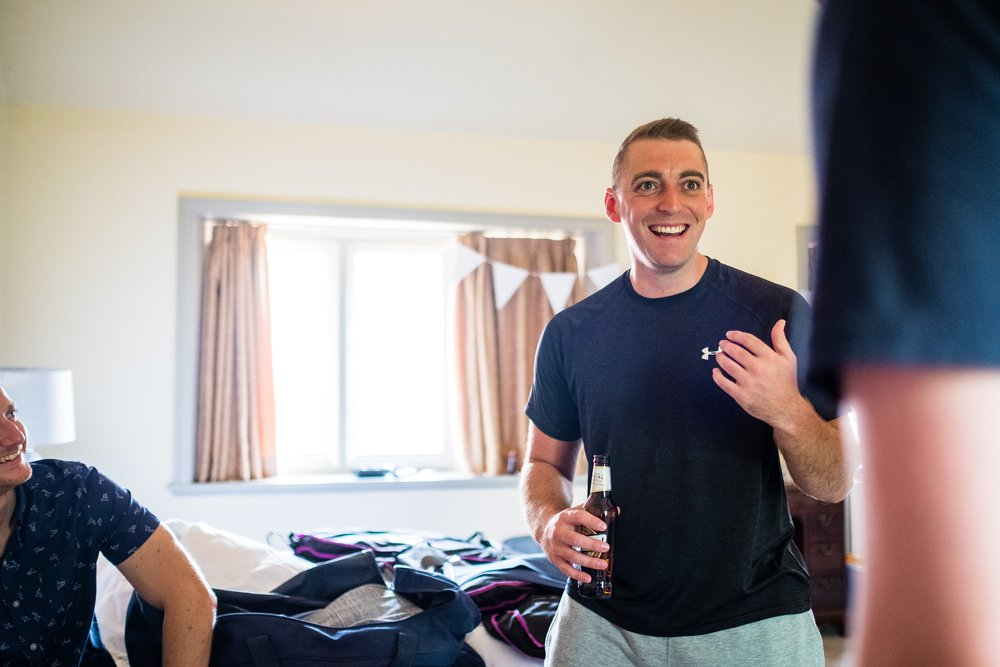 groom smiling during preperations