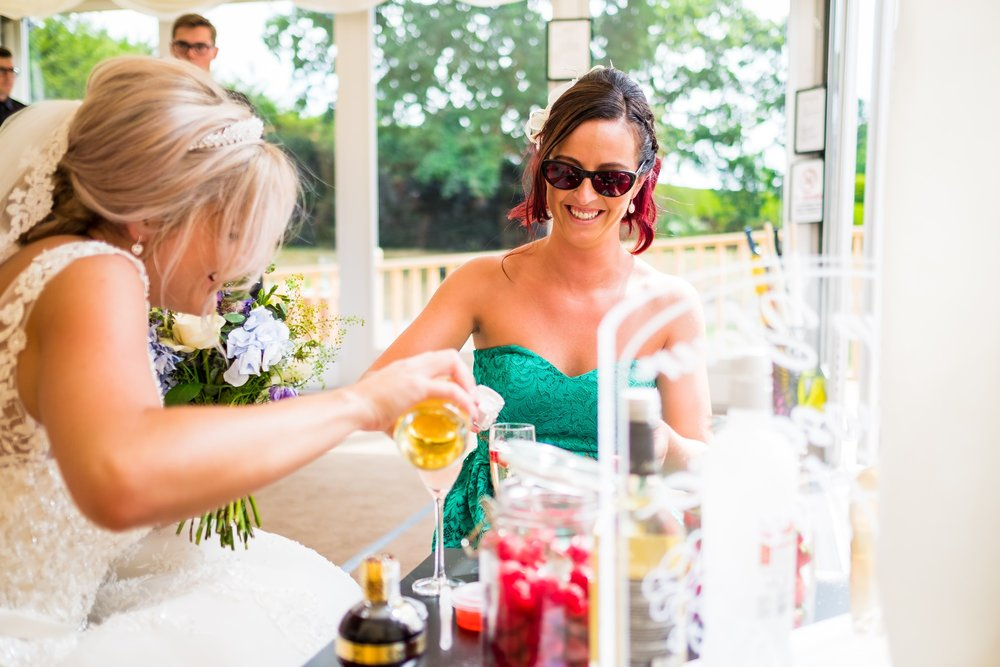 bride making gin with friend