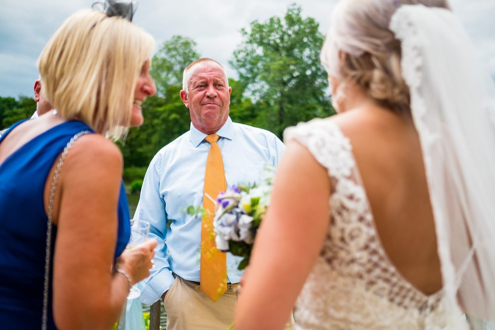 guests talking to bride