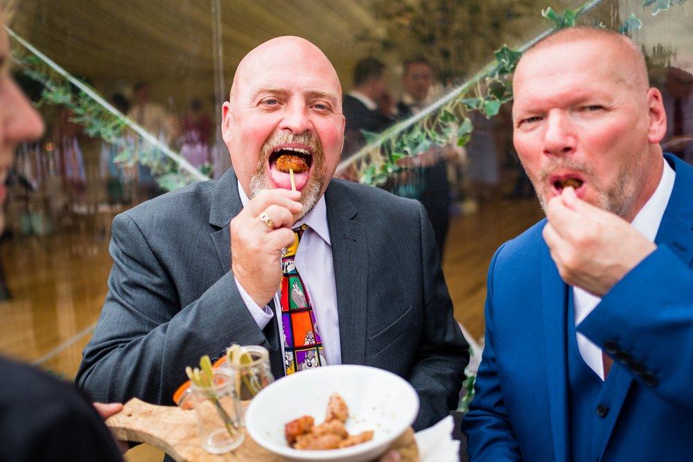 guests eating canapés
