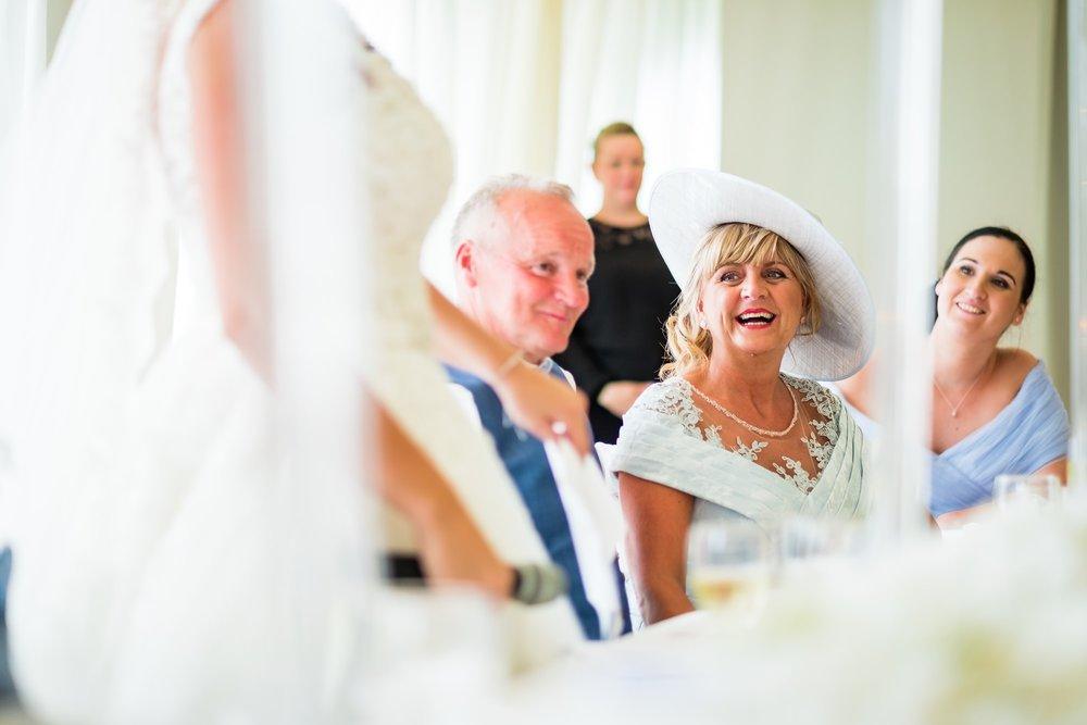 brides mum laughing during speeches