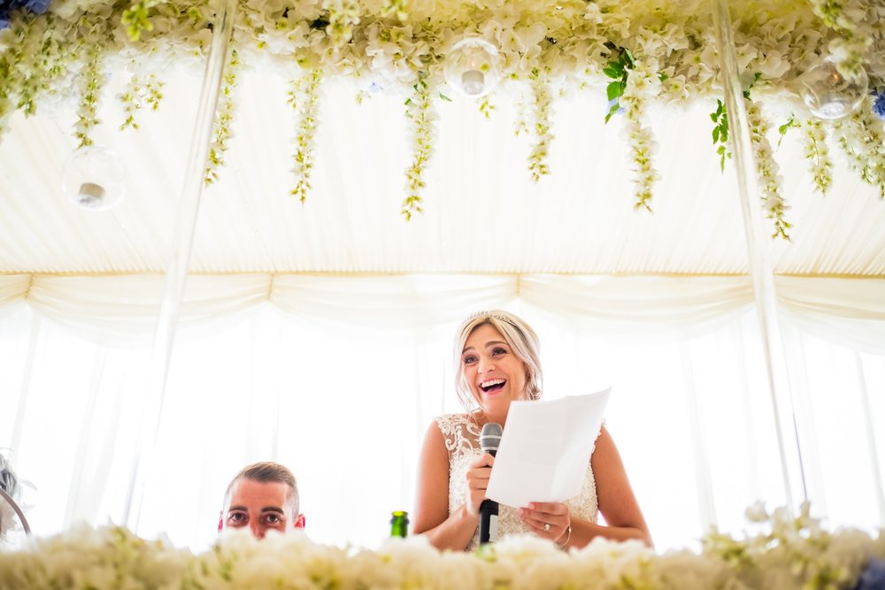 bride laughing during speech