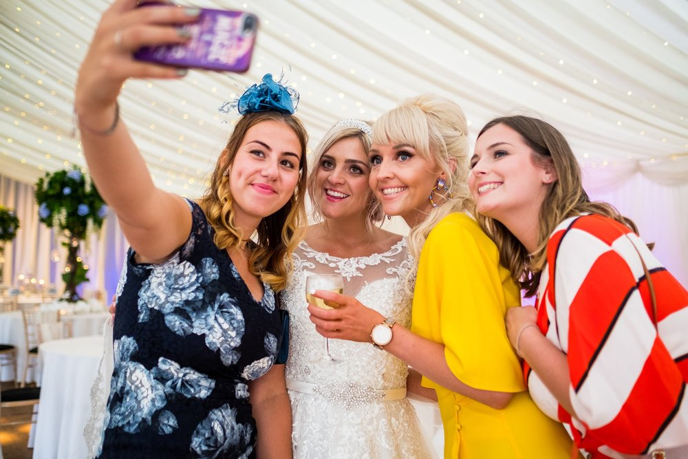 bride doing a selfie with friends