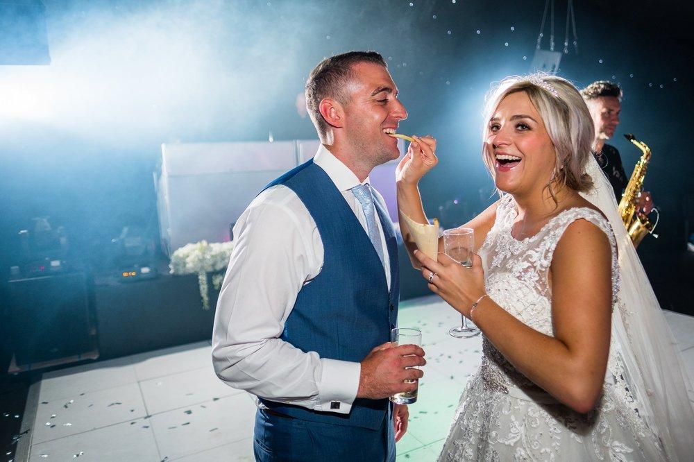 bride feeding chip to groom