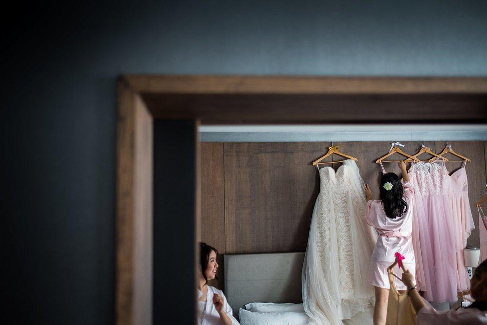 bridesmaids taking down wedding dresses