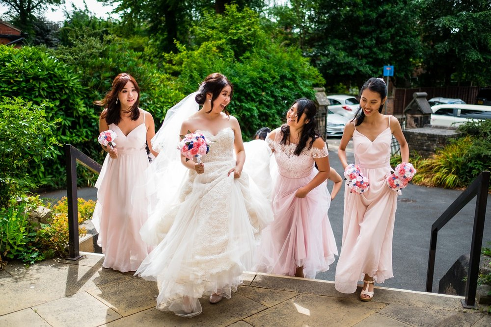 bride arriving at church with bridesmaids