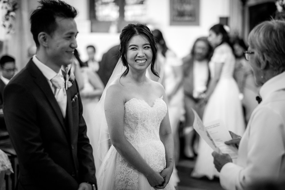 bride smiling to groom in Manchester church