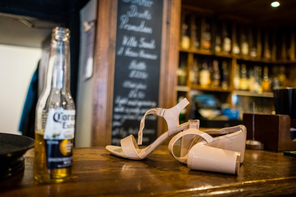 shoes and beer on bar
