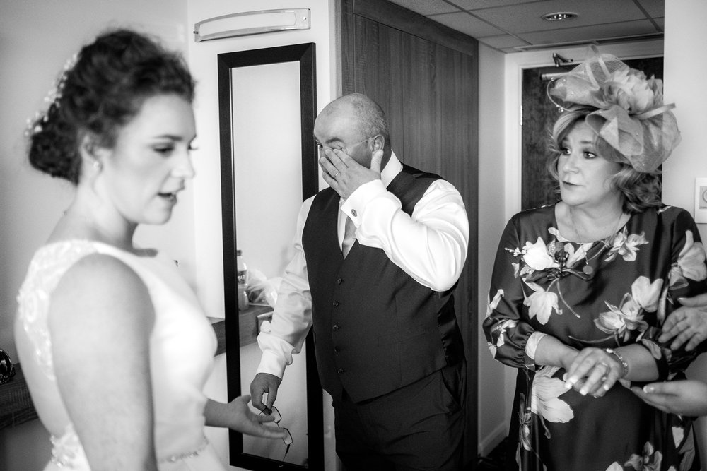 father of the bride wiping away a tear