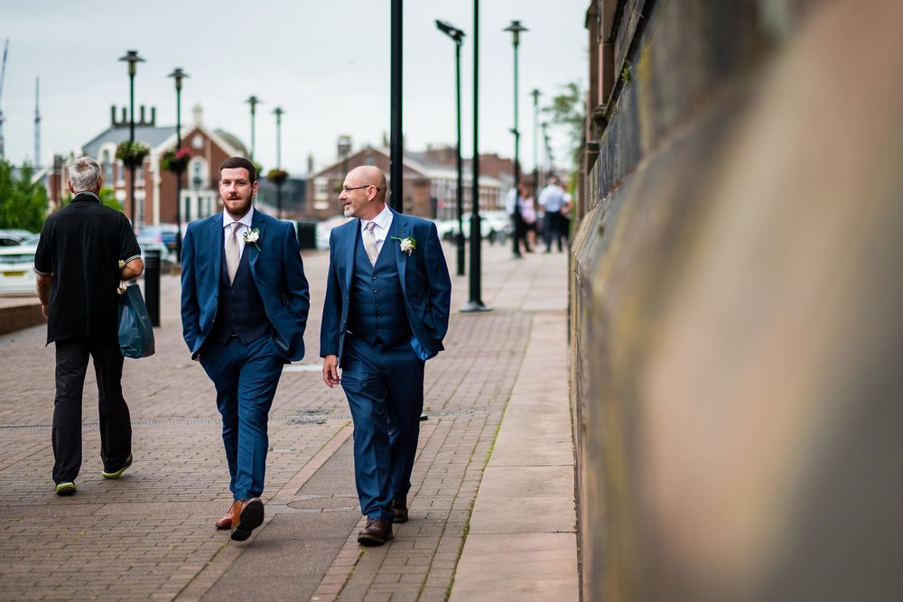 groom walking to Liverpool Cathedral