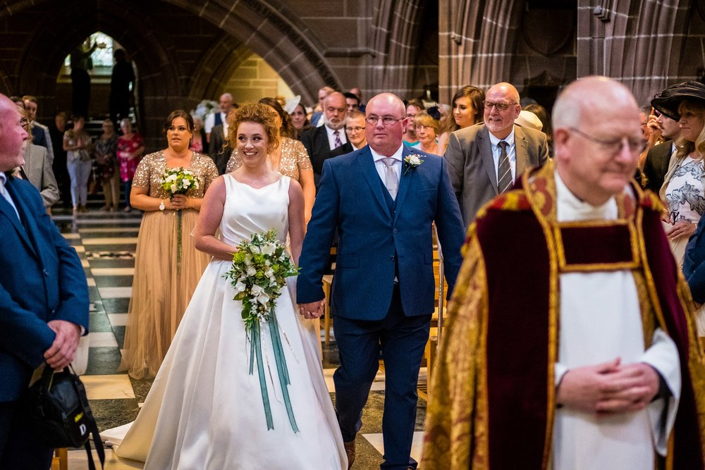 bride walking down the aisle in Liverpool Cathedral
