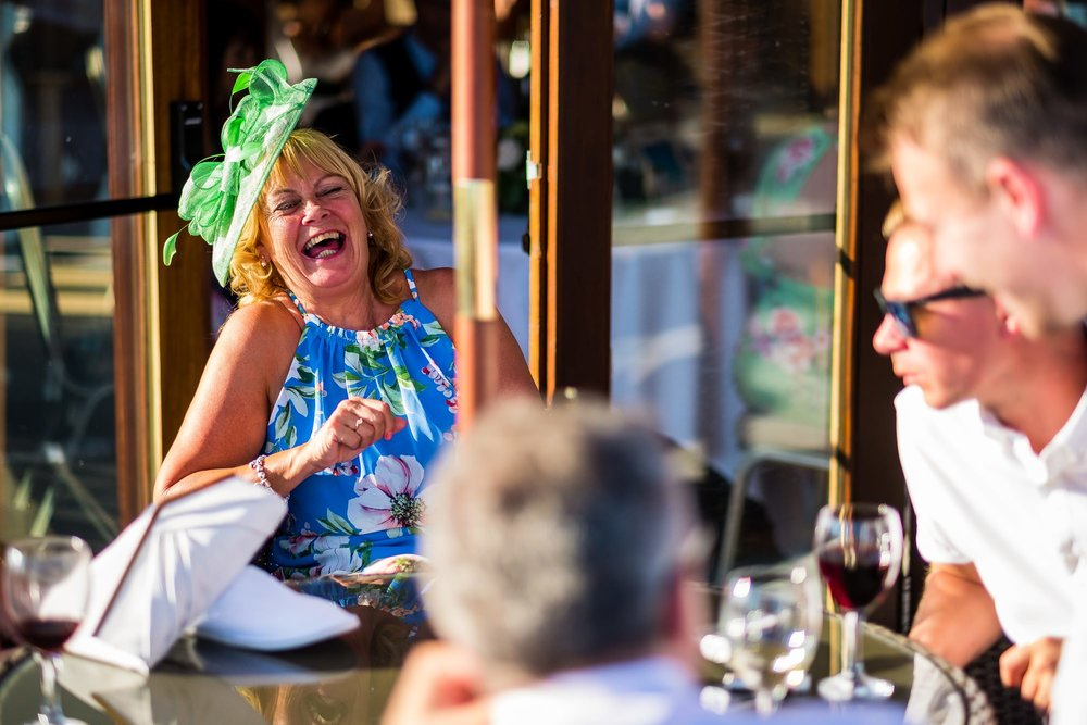 guest laughing sat at table