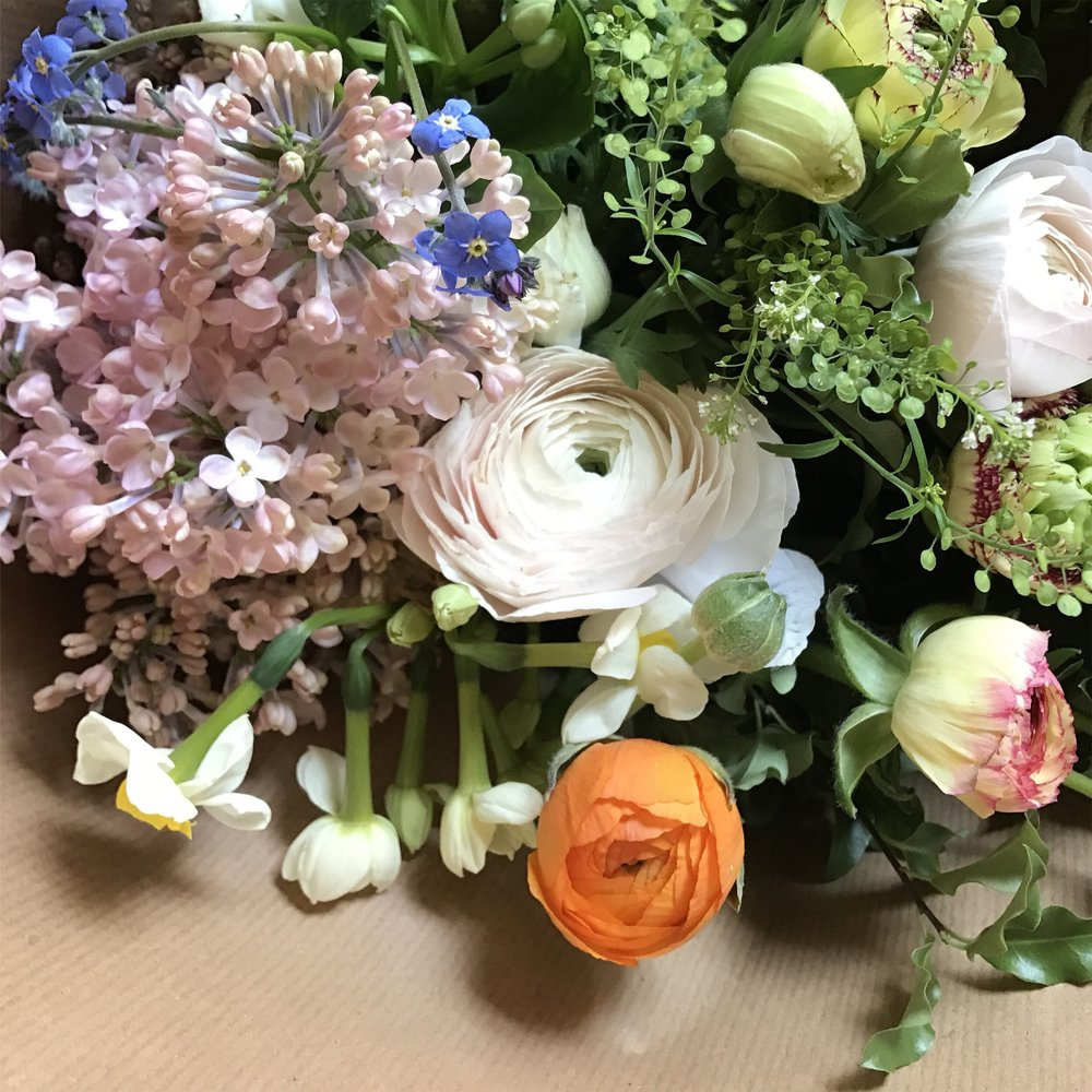 Lilac, ranunculus, scented narcissi and anemones