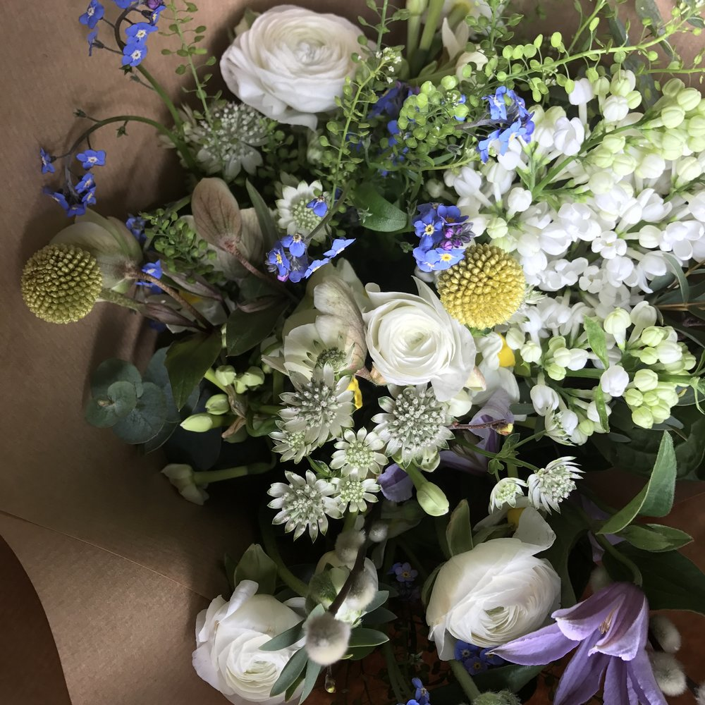 Lilac, ranunculus, astrantia, forget-me-nots and clematis