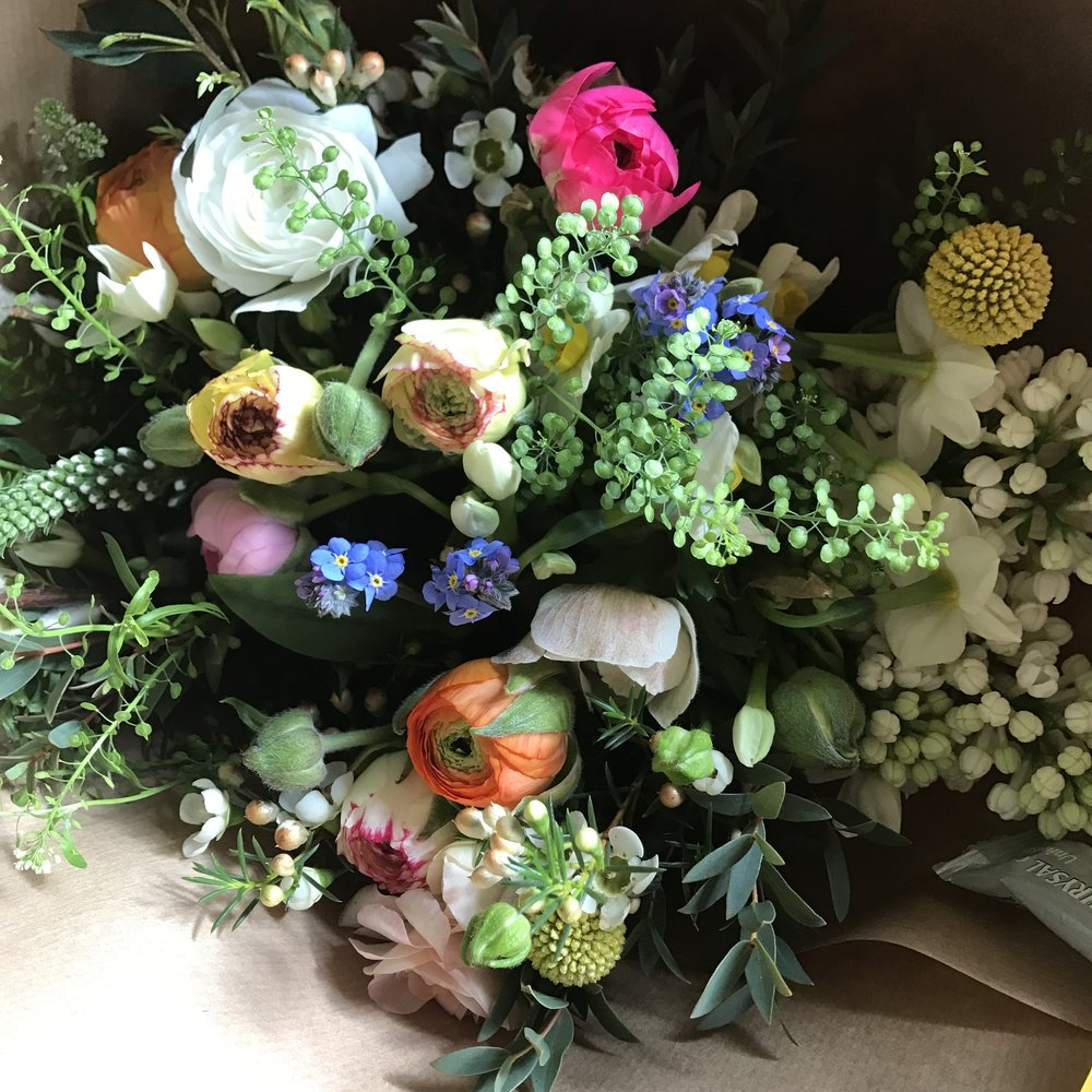 Ranunculus, lilac, scented narcissi and forget-me-nots