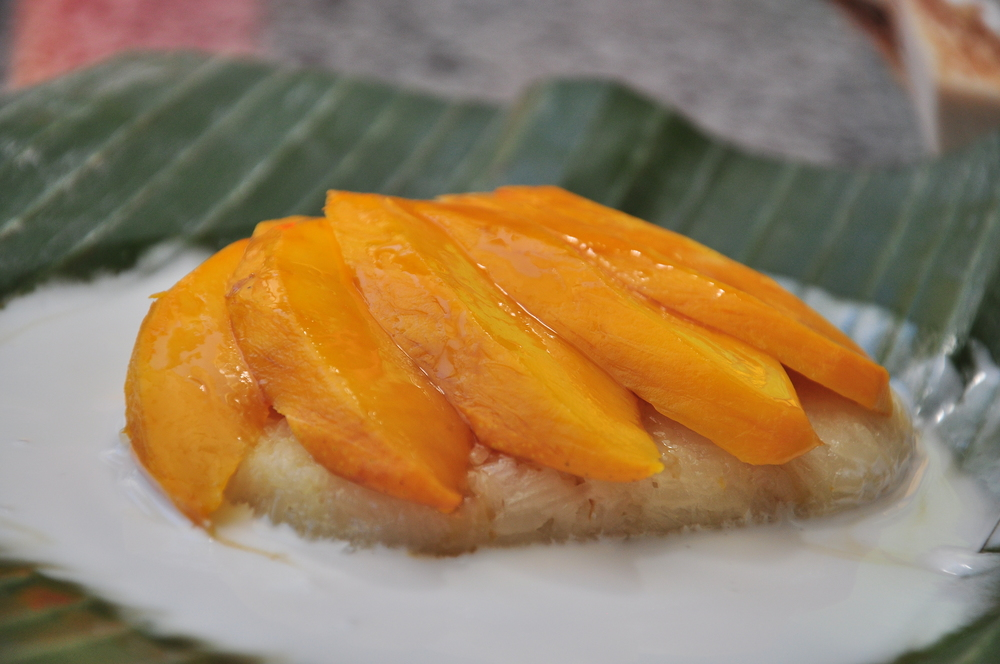Mango Sticky Rice - Sticky rice steamed with coconut milk. Topped with fresh mango and gula melaka.