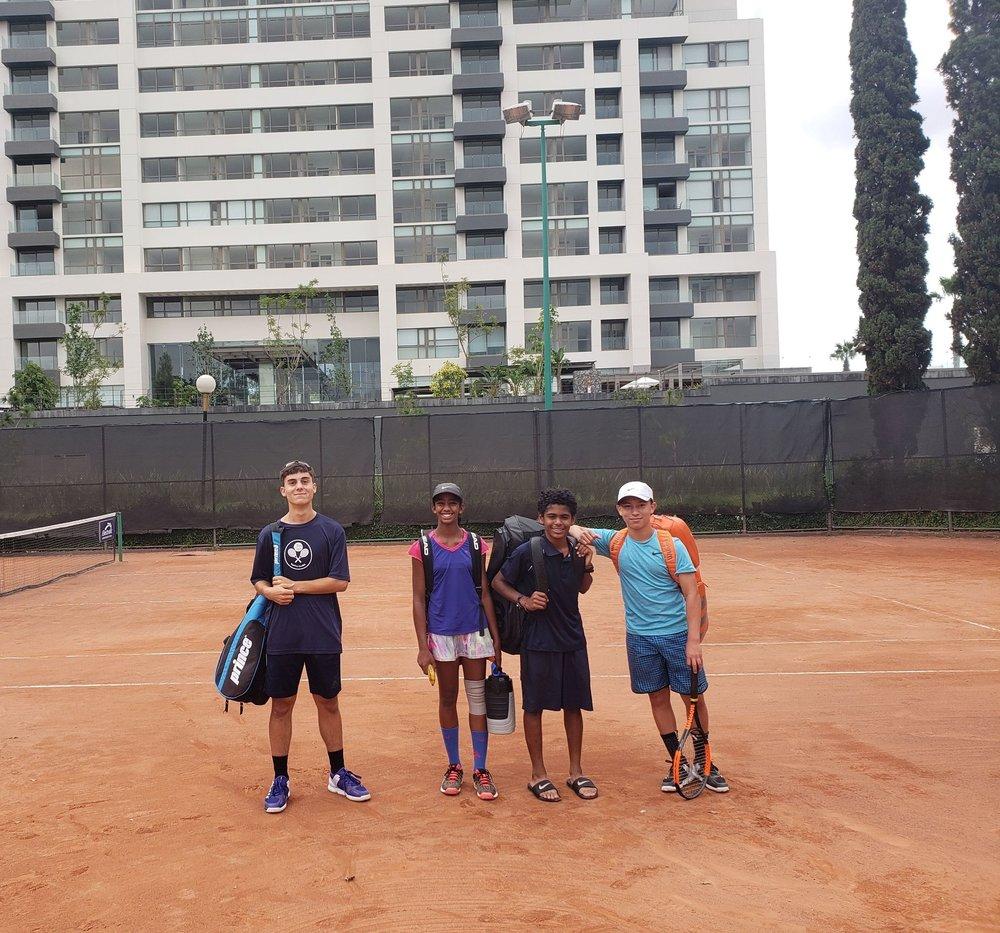 Right to left: Andre (14), Varsha(12), Santiago(13), Stephane(15) on red clay in Zapopan-Guadalajara, Mexico 2018