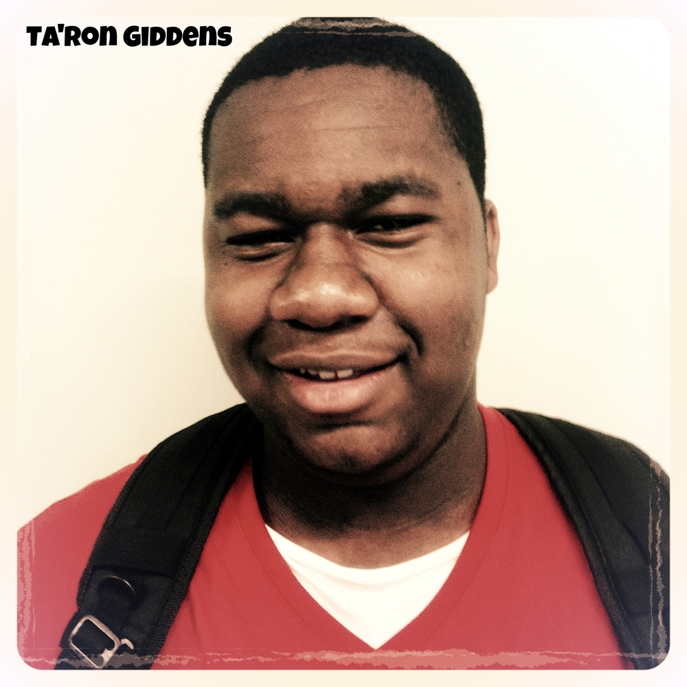 My name is Taron Giddens, and I'm from West Oakland. I am a really chill person. My favorite thing to do is relax and be me. What I want out of my community is for everyone to come together and be one with each other. That's what I want to do here through the WOYC.