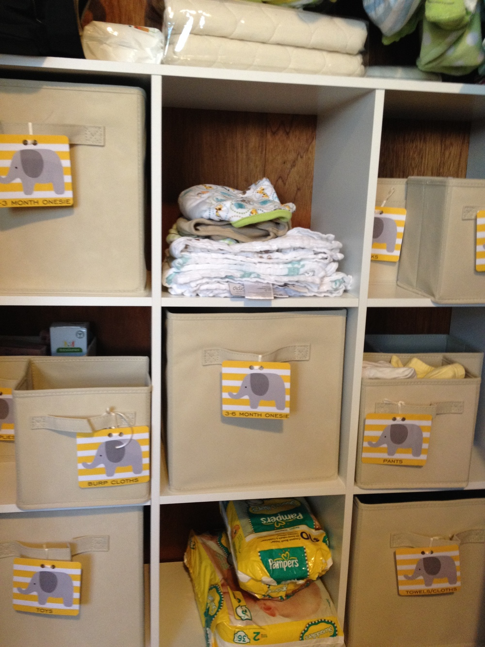 organized baby closet with tags