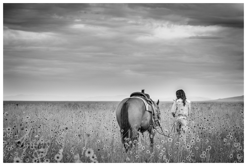 Cowgirl senior portrait with horse and sunflowers in New Mexcio ranch country