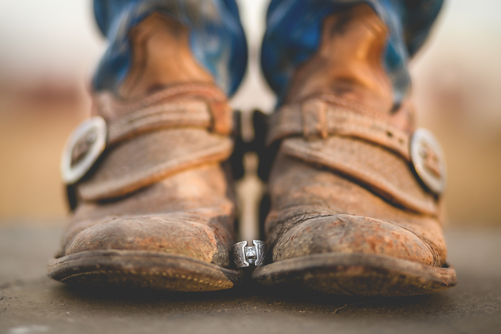 Cowboy boots with engagement ring. Lyndsey Garber Photography