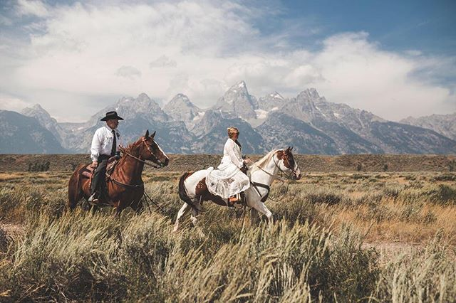 "That time Trissta and her dad rode down the ""aisle"" with a @grandtetonnps backdrop. #lgp_weddings"