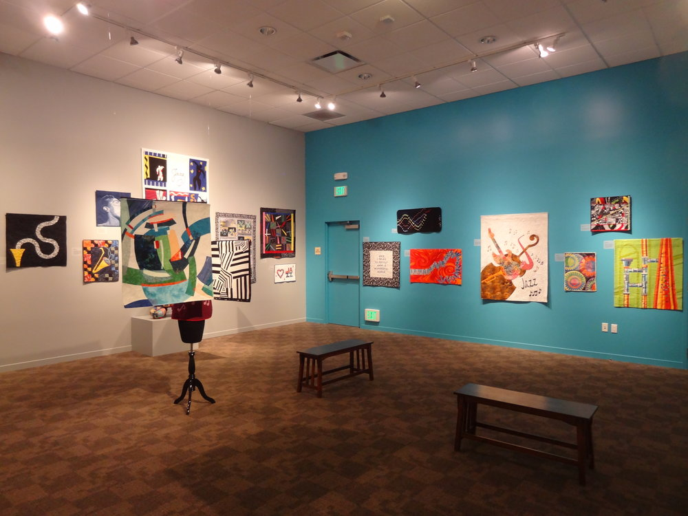 In  Jazz Impressions , members of the Santa Clara Valley Quilt Association displayed quilts and other fiber arts inspired by and in dialogue with jazz music.