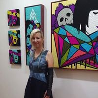 Amy Ahlstrom in front of her work