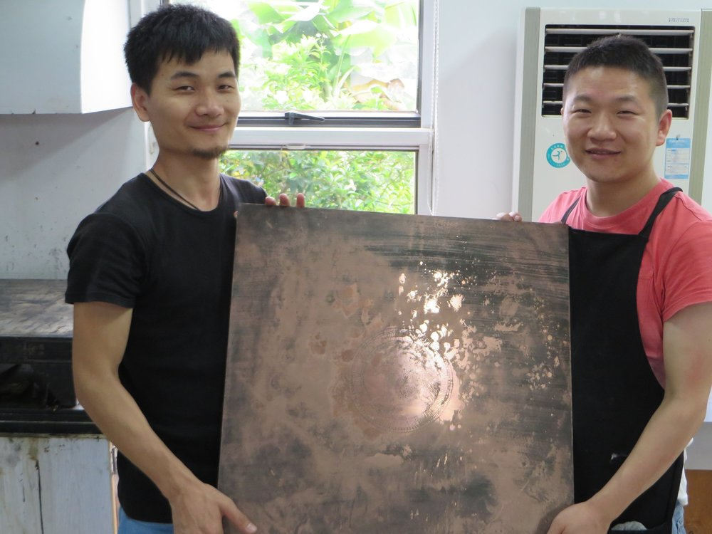 5-19-15  Gang Shi and Liu Hongliang with my plate at the Guanlan International Printmaking Base