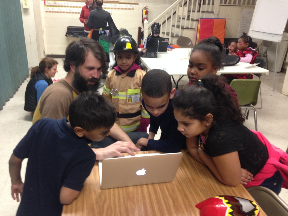 Zac Delagrange, Software Engineer at BitSight Technologies, shows children code at career day.