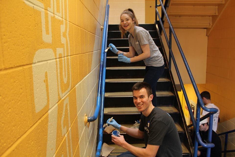 Volunteers paint the stairs at the 7th Annual MLK Day of Action