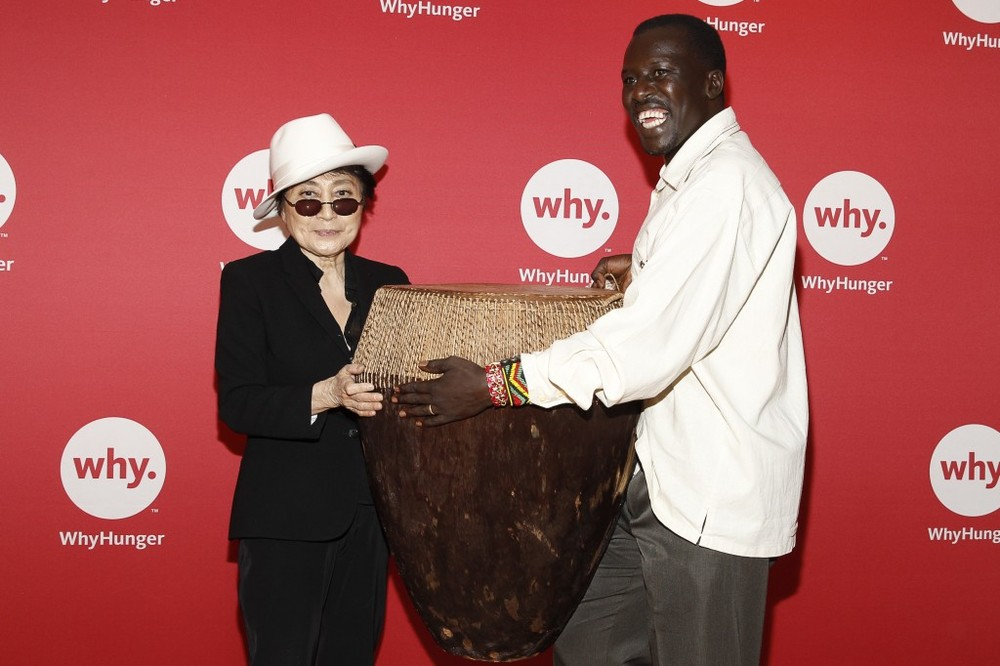Hope North Founder Okello Sam with Yoko Ono. CEA client Hope North is a beneficiary of the Imagine There's No Hunger campaign. © WhyHunger