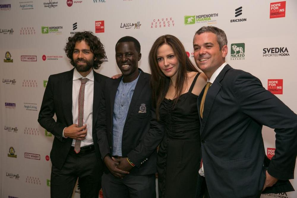 Cause Effect Agency's founder Chris Talbott with Adrian Grenier, Mary-Louise Parker, and Hope North's founder Okello Sam. © Phil Nee for Cause Effect Agency.