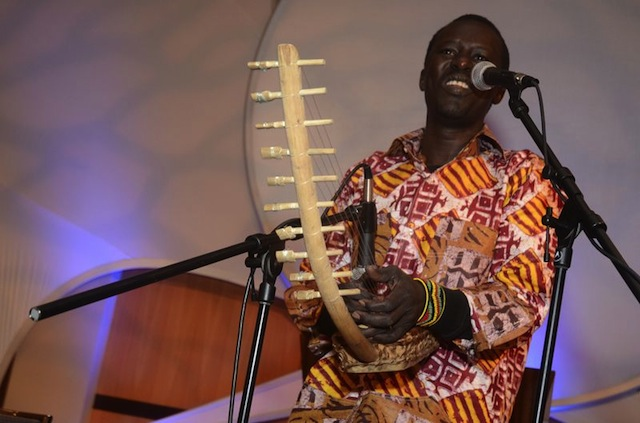 Okello sings, accompanying himself on the adungu. © Jim Berry and Aegis Living