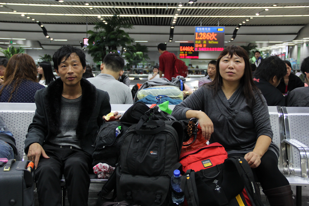 Yuan Zhitong (left) and Zhang Junmei (right) inside the waiting room at the Shenzhen train station before the long ride from Shenzhen to Shangqiu in Henan province, February 2013.