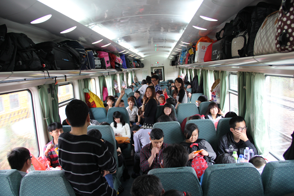 A lively atmosphere inside the Shenzhen-Zhengzhou train, a ride that takes more than 24 hours to complete. February 2013.
